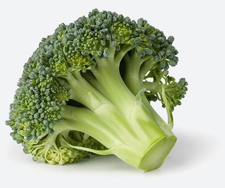 Broccoli resting on the surface of a table